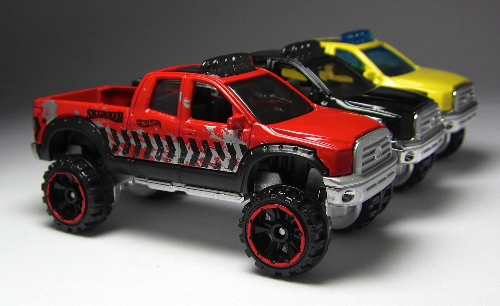 first look a pair of hot wheels toyota trucks. Black Bedroom Furniture Sets. Home Design Ideas